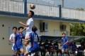 Cheung Wai-ki heads the ball away for Hong Kong. Photos: HKFA
