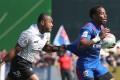 Alosio Sovita Naduva of Fiji chases Carlin Isles of the USA at the Dubai Sevens. Photo: AFP