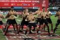 New Zealand celebrate with a haka after winning the Dubai Sevens. Photo: AFP