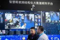 Visitors are filmed by AI security cameras using facial recognition technology at the 14th China International Exhibition on Public Safety and Security at the China International Exhibition Center in Beijing on October 24, 2018. Photo: AFP