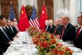 Chinese President Xi Jinping (left) and US President Donald Trump (second right) attend a working dinner after the G20 leaders summit in Buenos Aires on Saturday. Photo: Reuters