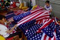 Chinese employees sew flags at a factory in Fuyang in eastern Anhui province, where trade with the US is an important component of business. Photo: AFP