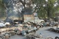 Smouldering vehicles litter the street following mob violence in Chingravati village in the Bulandshahr district of Uttar Pradesh. Photo: AFP