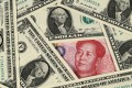 The yuan had its best day in two years against the US dollar on Monday. Photo: Kyodo