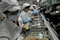 Chinese workers assemble electronic components at Foxconn's factory in Shenzhen. Photo: AFP