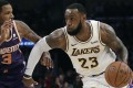 Los Angeles Lakers' LeBron James dribbles in a win over the Phoenix Suns. Photo: AP