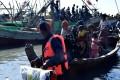 Myanmar navy personnel escort Rohingya Muslims back to their camp in Sittwe, Rakhine state. Photo: AFP