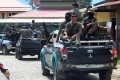 Indonesian Mobile Brigade Police head to Nduga, where 31 construction workers are believed to have been shot dead. Photo: AFP