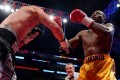 Oleksandr Gvosdyk (left) knocked out Adonis Stevenson in their WBC light-heavyweight title bout on Saturday. Photo: AFP