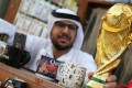 A mock-up of the World Cup is seen at a shop in Souk Waqif in Doha, Qatar. The 2022 edition of the tournament has been marred by endless controversy. Photo: Reuters