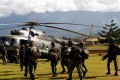 Indonesian soldiers walk towards a helicopter headed for Nduga district in Papua province. Photo: Reuters