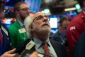 Traders work on the floor of the New York Stock Exchange on December 6. A miscommunication from the Fed can have amplified market effects, even if the statements contain a degree of truth. Photo: AFP
