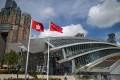 The flags of Hong Kong (left) and China are displayed outside West Kowloon Station. Photo: EPA