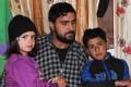 Khursheed Ahmad Sheikh with his son Misbah Khursheed, 7, and daughter Aalima Jan, 5. Photo: Saqib Mir