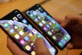 Staff at Menpad will be penalised if they purchase an Apple iPhone, the company said in a statement. Photo: Reuters