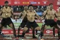 New Zealand players perform the haka after they beat the USA in the Dubai Sevens final. Photo: AP