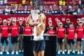 Ukraine's Dayana Yastremska lifts the Hong Kong Open trophy on October 14 at Victoria Park. Photo: Andy Cheung
