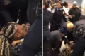 New York police officers, one of them wielding a stun gun, violently yanking a toddler from his mother's arms while arresting her at a Brooklyn food stamp office on Monday. Photo: YouTube