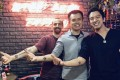 Luke Wagman of CoinMarketCap (left), Binance founder Zhao Changpeng (centre) and blockchain investor Gareth Lai show off their tattoos. Photo: Medium