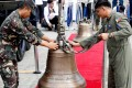 Philippine Air Force personnel unload the bells of Balangiga. Photo: Reuters