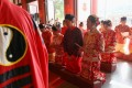 Ten couples hold a Taoist wedding ceremony at the Che Kung Temple in Sha Tin district of Hong Kong. Photo: Edmond So