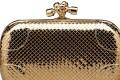 Bottega Veneta clutch with an 18ct gold knot