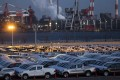 Toyota pickup trucks bound for shipment in a lot at night at the port in Nagoya. Photo: Bloomberg