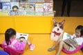 Children read at a booth at the Hong Kong Book Fair, at the Hong Kong Exhibition and Convention Centre in July. Photo: Winson Wong