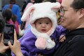 Bunny ears keep a child warm in Tsim Sha Tsui, as a cold snap hits Hong Kong on December 9. Photo: K.Y. Cheng