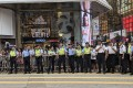 At the July 1 march the rights group claims it saw four plain-clothes officers following and filming two protesters holding a Hong Kong colonial-era flag. Photo: Sum Lok-kei