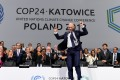 COP24 president Michal Kurtyka jumps at the end of the final session of the COP24 summit on climate change in Katowice, southern Poland, on December 15, 2018. Photo: AFP