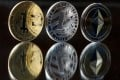 First generation of cryptocurrencies – bitcoin, litecoin, ethereum tokens. Photo: Bloomberg