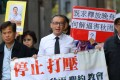 Hong Kong concern groups march on December 15 from the Western Police Station in Sai Ying Pun to the central government's liaison office, in support of Wang Yi, a pastor facing subversion charges in mainland China after a raid on his church. Photo: Edmond So