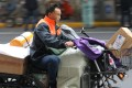 A man rides a motor bike to deliver goods for online shoppers in Shanghai on November 11, 2018. Some online retailers are offering customers the option of reusable packaging. Photo: SCMP/Simon Song