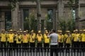 This file picture shows Meituan food delivery workers attending a morning briefing in Beijing. Photo: AFP