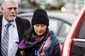 Huawei chief financial officer Sabrina Meng Wanzhou arrives at a parole office with a security guard in Vancouver, British Columbia, on Wednesday. Photo: AP