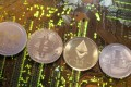 Representations of the ripple, bitcoin, ethereum and litecoin virtual currencies on a personal computer motherboard. The recent explosion of nearly 2,000 cryptocurrencies in a largely unregulated environment has greatly expanded the scope for abuse in the trading of these digital assets, according to a new study. Photo: Reuters