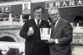 Tony Wang (left) with Peter Harman, the first global franchisee of KFC, in Beijing.