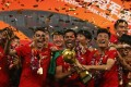 Shanghai SIPG players celebrate winning the Chinese Super League. Photo: AFP