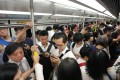 A crowded carriage on October 16, when a signalling fault on the MTR network caused a six-hour disruption to services. At least one passenger is displaying backpack etiquette. Photo: Felix Wong