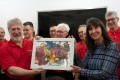 Co-founder Phyllis Marwah presents a painting by one of the children at the Child Care Home to the Hong Kong Male Welsh Choir during their visit. Photo: courtesy of Mother's Choice