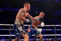 Josh Warrington and Carl Frampton go toe-to-toe for the IBF world featherweight title at Manchester Arena. Photo: Reuters