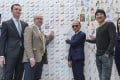 (From left) SCMP's Lawrence Wong, Kowloon Shangri-La resident manager Conor Hadlington, RTHK's Hugh Chiverton, Professor Jimmy Choo, Danny Choo and local artiste Skye Chan with the display. Photo: Edward Wong