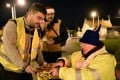 Yellow vest protestors eating at a roundabout on Christmas eve in Somain, northern France. Photo: AFP