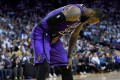 LeBron James leans over in pain after he was hurt against the Golden State Warriors. Photo: AFP