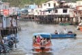 Tourists and locals hop on a speedboat for a look around Tai O fishing village and nearby waters. Photo: David Wong