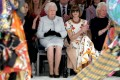 Britain's Queen Elizabeth II views Richard Quinn's runway show before presenting him with the inaugural Queen Elizabeth II Award for British Design at London Fashion Week in February. Photo: Reuters