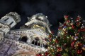 The Kaiser Wilhelm Memorial Church is seen behind a decorated Christmas tree, in Berlin. Photo: EPA