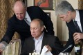 In this 2011 file photo, Russian businessman Yevgeny Prigozhin (left) serves food to Vladimir Putin during dinner at Prigozhin's restaurant outside Moscow. Prigozhin's firm Concord Management and Consulting has been indicted for allegedly bankrolling a secret social media campaign to sway the 2016 US presidential election in Donald Trump's favour. Photo: AP