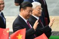 Chinese President Xi Jinping (C) and Vietnam's Communist Party Secretary General Nguyen Phu Trong (R). Photo: AFP